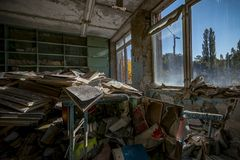 Many scattered books in the classes of the abandoned schoo. L in Pripyat stock images