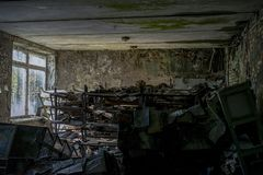 Many scattered books in the classes of the abandoned school. In Pripyat royalty free stock photography
