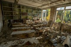 Many scattered books in the classes of the abandoned school. In Pripyat stock photo
