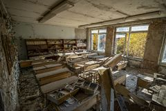 Many scattered books in the classes of the abandoned school. In Pripyat stock image