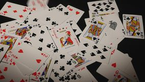 Many scattered playing cards on the table stock images