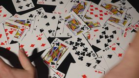 Many scattered playing cards on the table royalty free stock photography