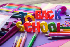Many school stationery in a heap in the middle of Back to School subtitles Stock Images