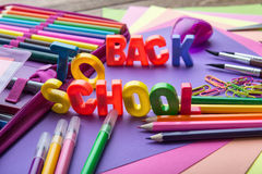 Many school stationery in a heap in the middle of Back to School subtitles Stock Image