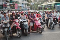 Many scooter driver and motorbikes at traffic light on Saigon st Stock Photos