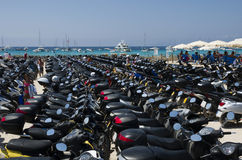 Many scooters parked near the beach Stock Images