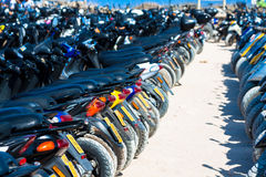 Many scooters on the parking,formentera ,spain AUGUST 21,2013 Royalty Free Stock Image