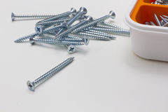 Many screws and a box Royalty Free Stock Photo