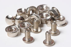 Many screws and nuts. The closeup of many screws and nuts Stock Image