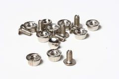 Many screws and nuts isolated on white background. The closeup of many screws and nuts Royalty Free Stock Photography