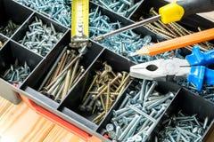 Many screws in plastic organizer box, work tools. Many screws in plastic organizer box top view Royalty Free Stock Photo