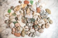 Free Many Sea Colored Stones, Sea Stones On Marble, Composition Of Rocks, Composition Of Sea Stones, Sea Stones On Marble Slab Royalty Free Stock Images - 182580169