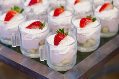 Many servings of sweet tasty dessert on buffet Stock Photography