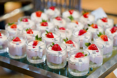 Many servings of sweet tasty dessert on buffet Stock Photo