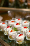 Many servings of sweet tasty dessert on buffet Stock Images