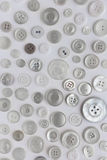 Many sewing buttons assorted on white background Stock Photos