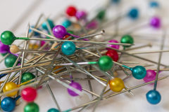 The many sewing push pins on the white background Stock Photo