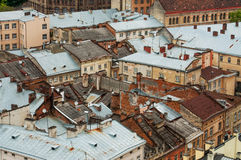 Many shabby roofs of old city from the top Stock Images