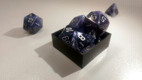 Many shapes of dice Stock Images