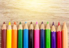 Many Sharp Color Pencil. On The Empty Brown Wood Blank Background Stock Photo
