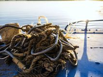 Poaching equipment in a boat. Many sharp hooks for sturgeon fishing Royalty Free Stock Photo