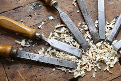 many sharp steel blades many chisels and sawdust chippings in Wo Stock Images