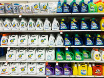 Many shelves containing a variety of laundry detergents. A store in America with five shelves of various laundry detergents including All, Purex, and Era.  Many Royalty Free Stock Photography