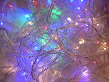 Many shining, colorful lights strings for a party Stock Image