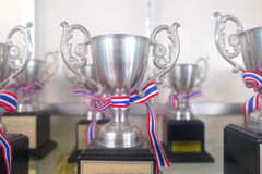 Many shiny silver trophies. Display many shiny silver trophies stock images