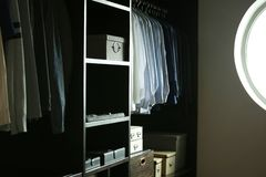 Many shirts in closet clothes room stock photography