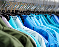 Many shirts hanging in color Royalty Free Stock Images