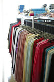 Many shirts in shop Stock Image