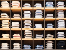 Many shirts in showwindow of boutique Stock Image