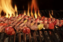 Many Shish Kebab On The BBQ Flaming Charcoal Grill Stock Photography
