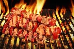 Many Shish Kebab On The BBQ Flaming Charcoal Grill Royalty Free Stock Photo