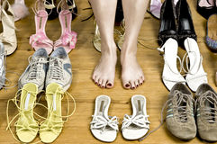 Many shoes and feet Stock Photo