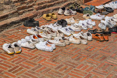 Many shoes. On floor stock image
