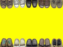 Many of shoes and sandal on isolate yellow background. Suitable for a background or accompanying an article about shoes stock image