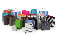 Many shopping bags. Photo of a large group of colourful shopping bags. Clipping path included. Shadows visible Royalty Free Stock Photos