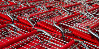Many shopping carts. Shopping carts lined up waiting for customers Royalty Free Stock Image