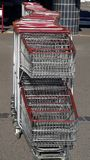 lined supermarket trolleys stock photos