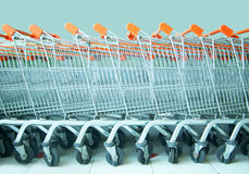Many shopping trolley. In the supermarket there are many rows of shopping trolley Royalty Free Stock Photography