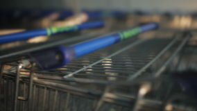 Many shopping trolley in a supermarket stock video footage