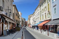 Shopping street in the Corsican town Saint-Florent Royalty Free Stock Image