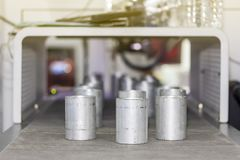 Many short pipe product on automatic belt conveyor during manufacturing process in factory.  stock photography
