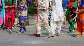 Many Sikhs  women barefoot while scavenging the road Stock Photos