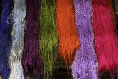 Many silk threads Hanging on the rail stock photos