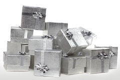Many silver gifts in a pile. Pile of the many silver presents Stock Images