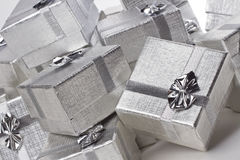 Many silver gifts in a pile on white stock images