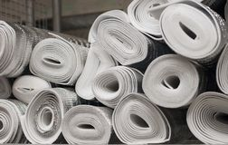 Many silver large rolls of foil insulation stock image